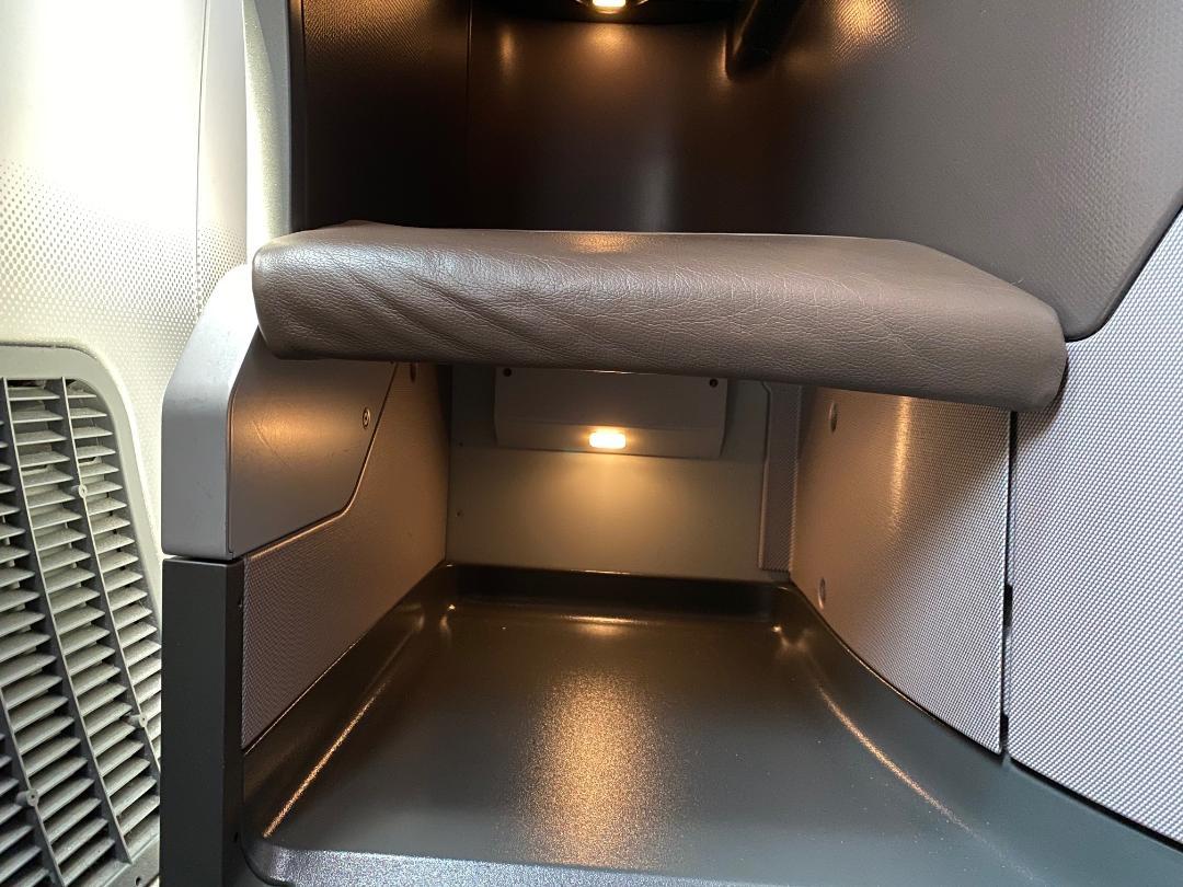 Storage under the footrest